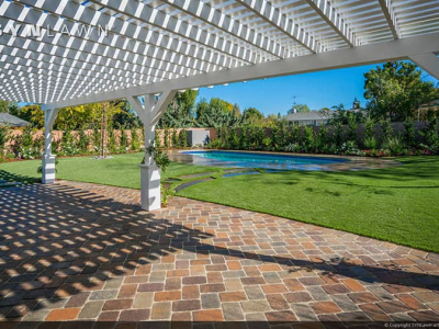 SYNLawn-artificial-grass-residential-backyard-landscape-pool-and-pavers